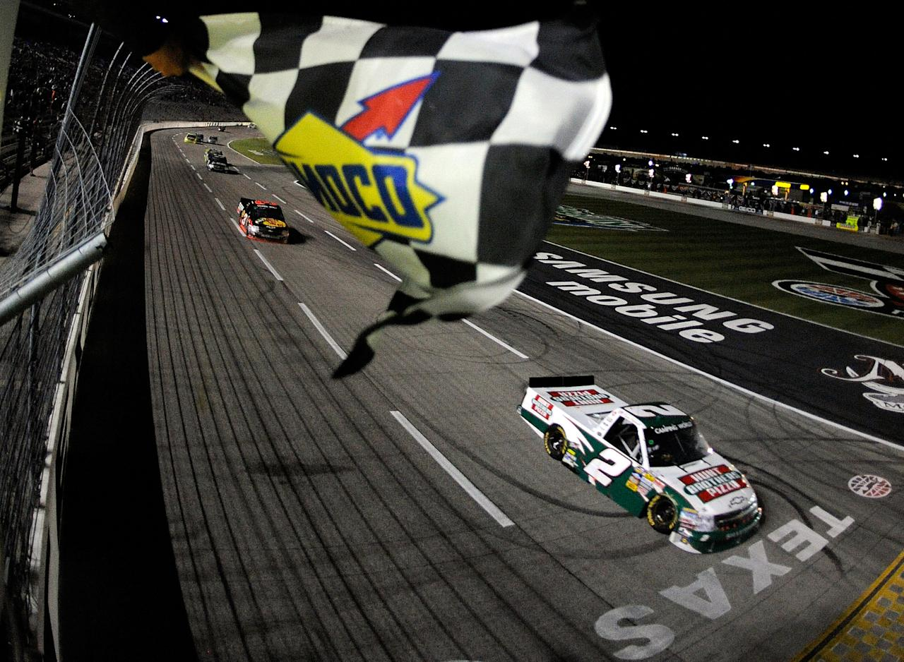 FORT WORTH, TX - NOVEMBER 04:  Kevin Harvick, driver of the #2 Hunt Brothers Pizza Chevrolet, heads towards the start finish line to take the checkered flag and win the NASCAR Camping World Truck Series WinStar World Casino 350k at Texas Motor Speedway on November 4, 2011 in Fort Worth, Texas.  (Photo by Jared C. Tilton/Getty Images for NASCAR)