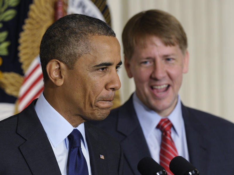 Obama commends work of consumer protection agency