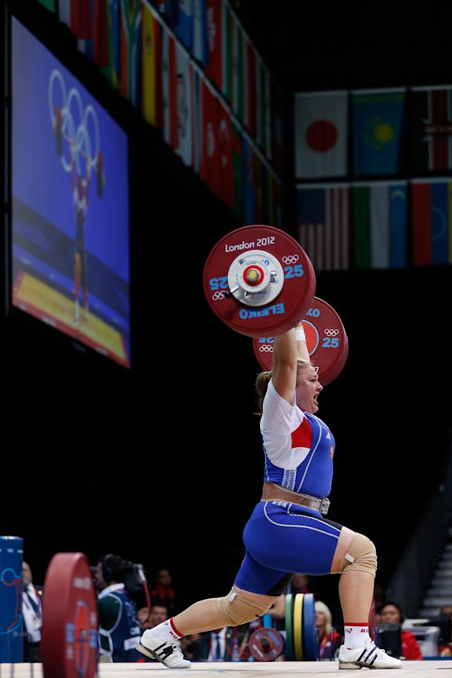 LONDON, ENGLAND - AUGUST 05:  Tatiana Kashirina of Russia competes during the Women's 75kg Weightlifting on Day 9 of the London 2012 Olympic Games at ExCeL on August 5, 2012 in London, England.  (Photo by Jamie Squire/Getty Images)