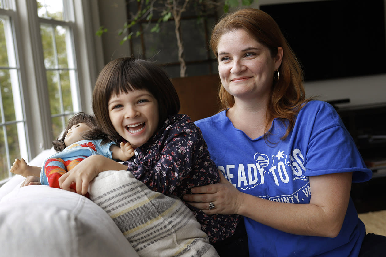 "Molly Lovato, a volunteer with the Obama campaign, poses for a photograph with her daughter Nola Trindade, 4, at their home in Leesburg, Va. Lovato credits the president with steering the country away from financial disaster. ""I think he kept us from sliding into a depression,"" she says. ""I'm really dumbfounded by people who say 'Why didn't he fix this?' and it's 20 minutes later."" She compares reviving the economy to gutting and then rehabbing a home. ""It takes a hot minute for everything to unravel,"" she says, ""but to put it back together is really very difficult."""