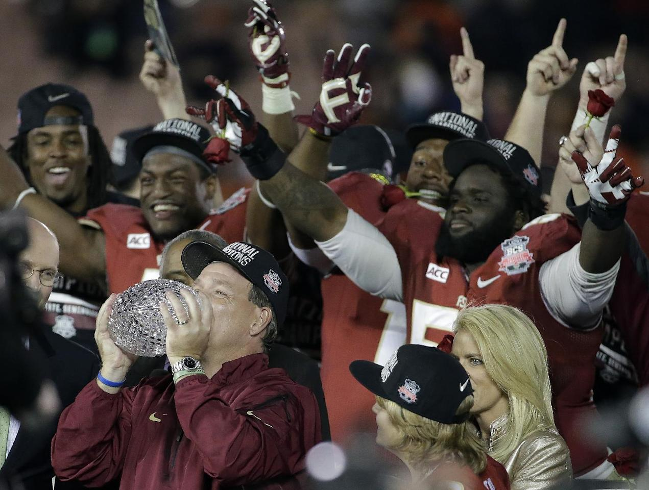 Florida State head coach Jimbo Fisher kisses The Coaches' Trophy after the NCAA BCS National Championship college football game against Auburn Monday, Jan. 6, 2014, in Pasadena, Calif. Florida State won 34-31. (AP Photo/Chris Carlson)