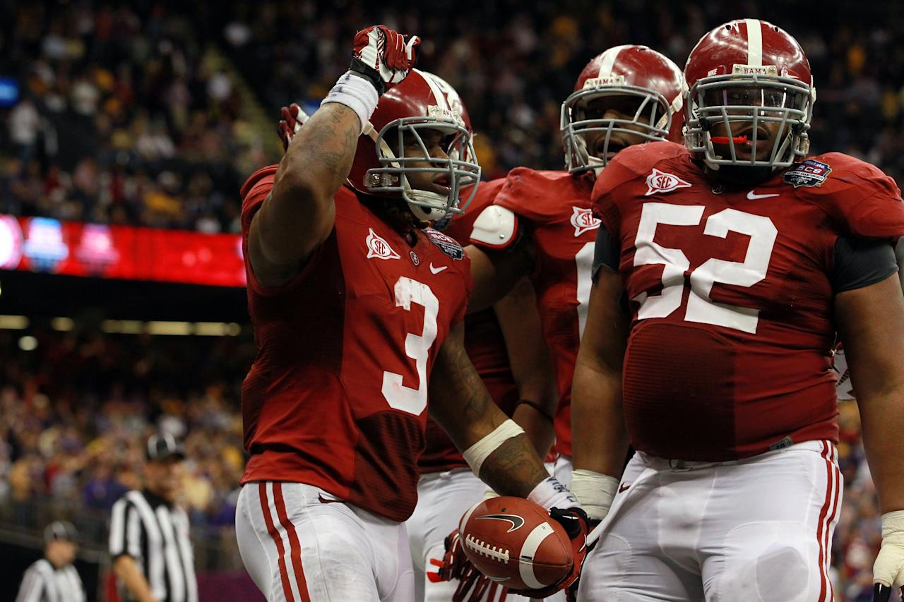 NEW ORLEANS, LA - JANUARY 09:  Trent Richardson #3 of the Alabama Crimson Tide celebrates with Alfred McCullough #52 after scoring a touchdown in the fourth quarter against the Louisiana State University Tigers during the 2012 Allstate BCS National Championship Game at Mercedes-Benz Superdome on January 9, 2012 in New Orleans, Louisiana.  (Photo by Ronald Martinez/Getty Images)