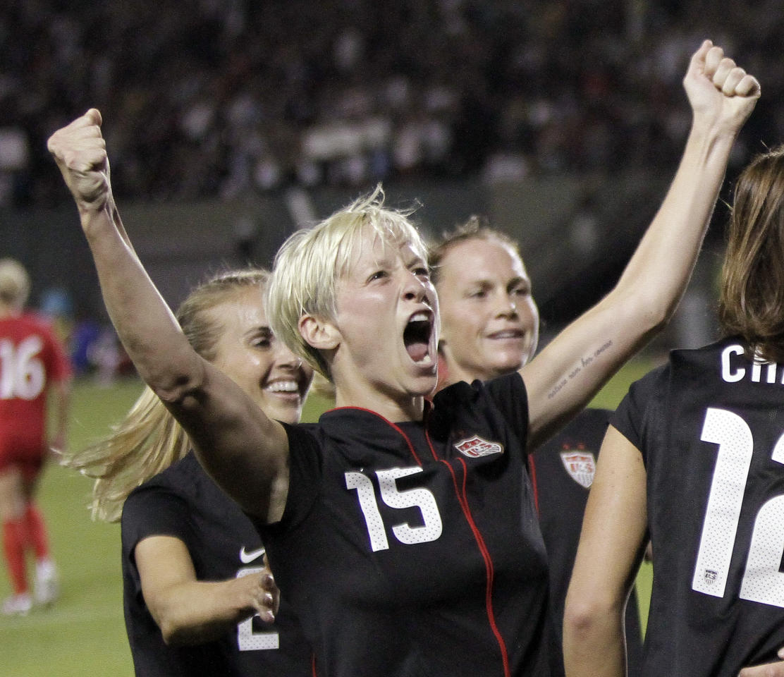 US Women's National Team midfielder Megan Rapinoe celebrates a teammate's goal during the second half of their Celebration Series soccer game against Canada in Portland, Ore., Thursday, Sept. 22, 2011. The US beat Canada 3-0.(AP Photo/Don Ryan)