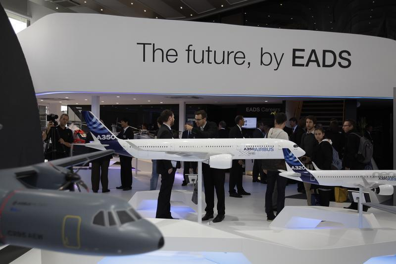 Visitor look at aircraft models at EADS booth ILA Berlin Air Show in Selchow