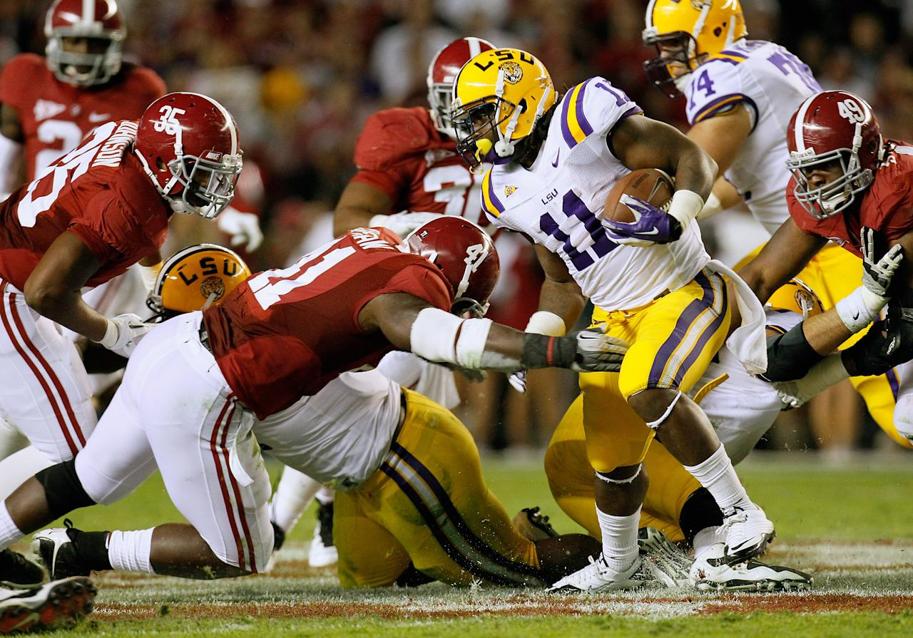 TUSCALOOSA, AL - NOVEMBER 05:  Spencer Ware #11 of the LSU Tigers rushes away from Ed Stinson #49 of the Alabama Crimson Tide during the game at Bryant-Denny Stadium on November 5, 2011 in Tuscaloosa, Alabama.  (Photo by Kevin C. Cox/Getty Images)