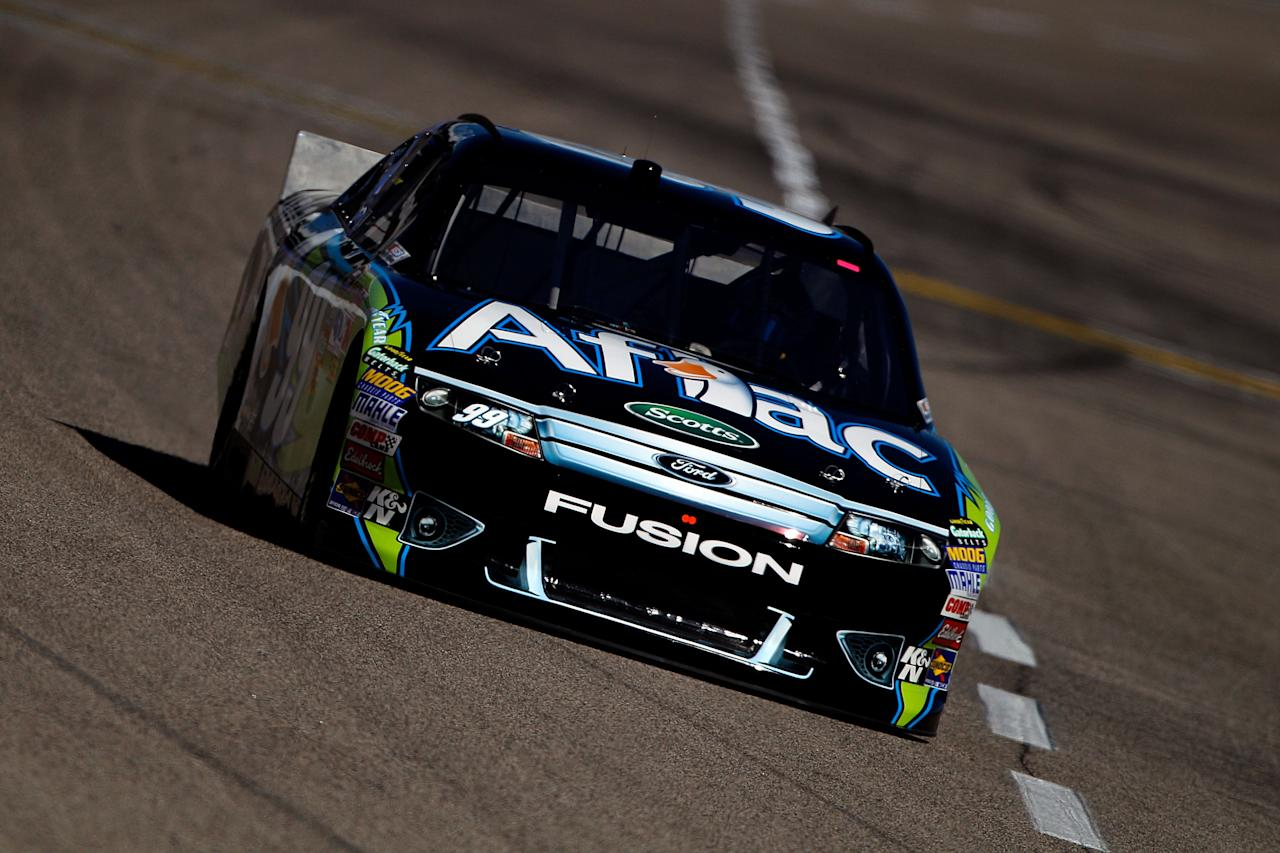 FORT WORTH, TX - NOVEMBER 04:  Carl Edwards, driver of the #99 Aflac Ford, drives on track during practice for the NASCAR Sprint Cup Series AAA Texas 500 at Texas Motor Speedway on November 4, 2011 in Fort Worth, Texas.  (Photo by Chris Graythen/Getty Images)