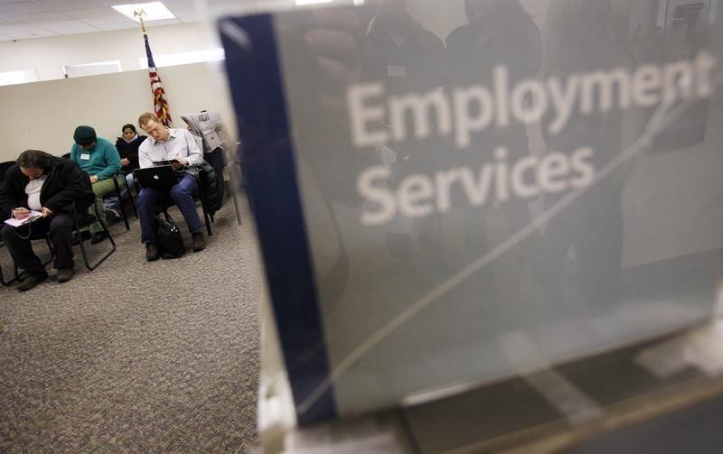 People fill out paperwork before attending an orientation class at the Manhattan branch of the New York State Department of Labor