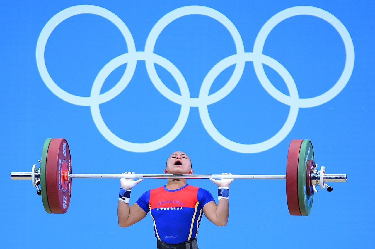 LONDON, ENGLAND - JULY 28:  Betsi Gabriela Rivas Arteaga of Venezuela competes in the Women's 48kg Group A weightlifting on Day 1 of the London 2012 Olympic Games at ExCeL on July 28, 2012 in London, England.  (Photo by Laurence Griffiths/Getty Images)