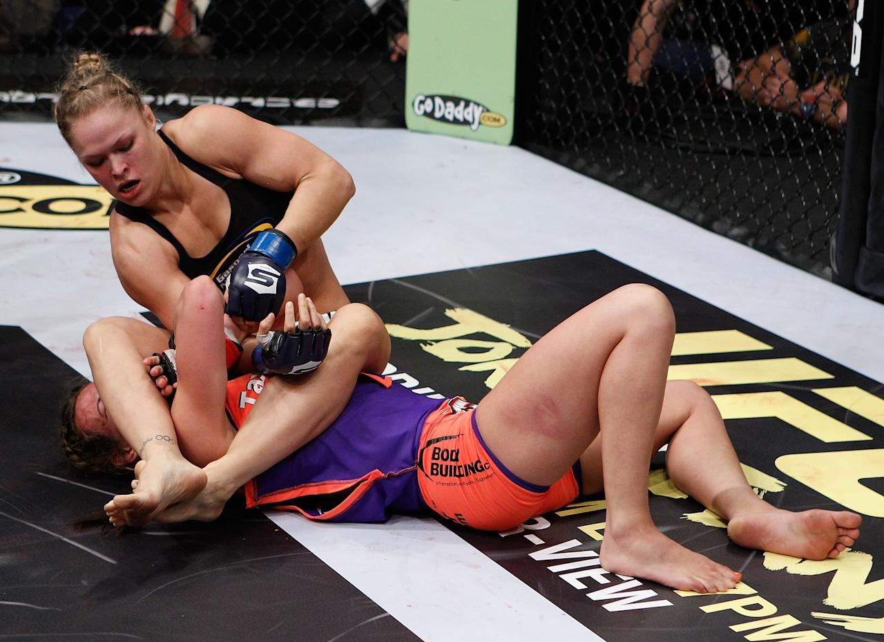 COLUMBUS, OH - MARCH 03:  Ronda Rousey (top) attempts to submit Miesha Tate during the Strikeforce event at Nationwide Arena on March 3, 2012 in Columbus, Ohio.  (Photo by Esther Lin/Forza LLC/Forza LLC via Getty Images)