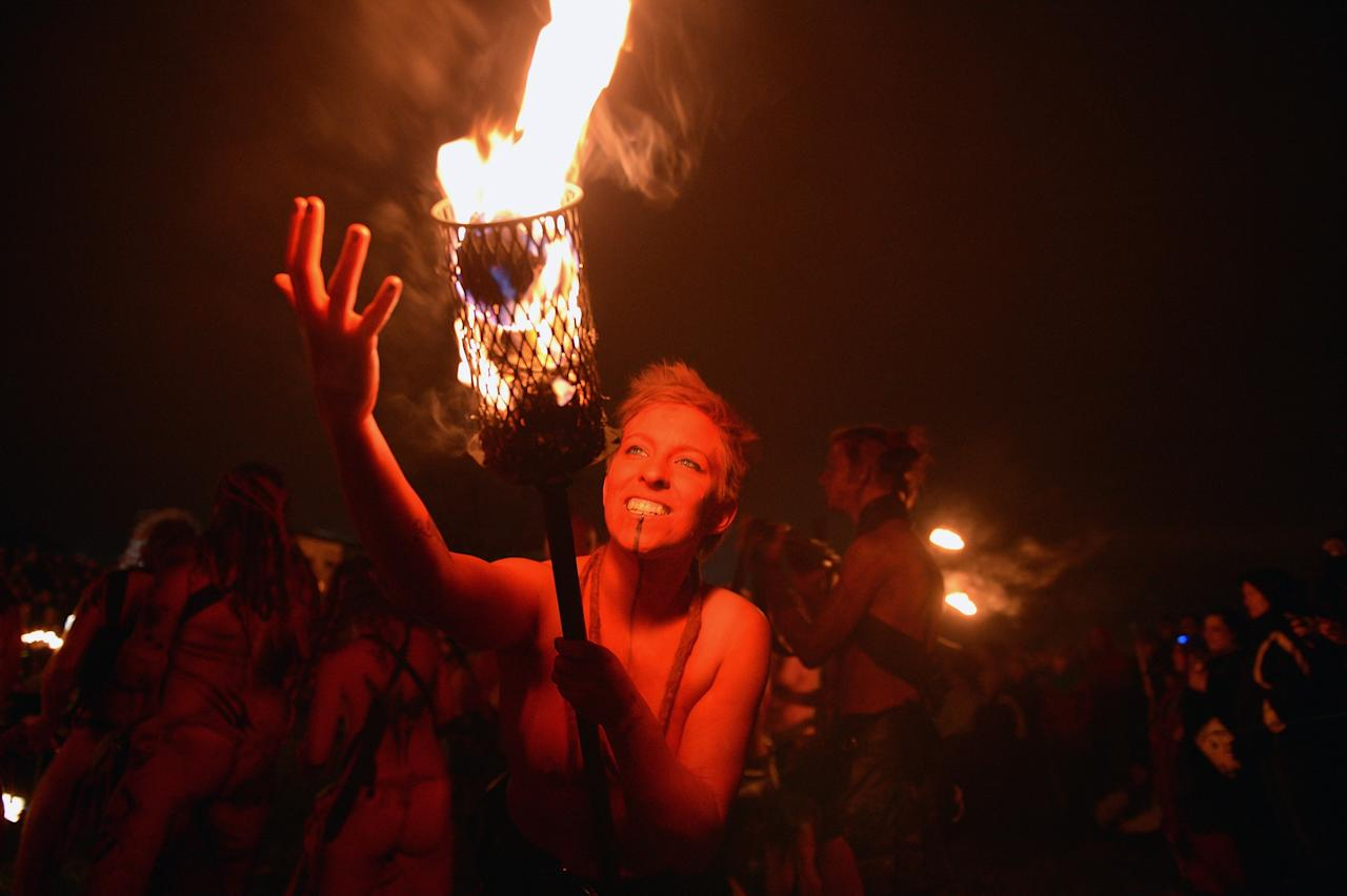 EDINBURGH, SCOTLAND - APRIL 30:  Beltane Fire Society performers celebrate the coming of summer by participating in the Beltane Fire Festival on Calton Hill April 30, 2013 in Edinburgh, Scotland. The event celebrates the ending of winter and is a revival of the ancient Celtic and Pagan festival of Beltane, the Gaelic name for the month of May. The festival was first organized in the mid 1980's.  (Photo by Jeff J Mitchell/Getty Images)