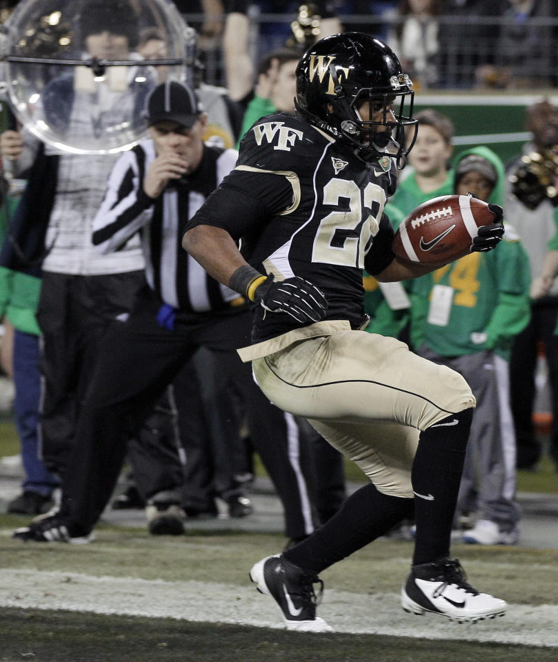 Wake Forest running back Brandon Pendergrass (22) scores a touchdown on a 14-yard run against Mississippi State in the first quarter of the Music City Bowl NCAA college football game on Friday, Dec. 30, 2011, in Nashville, Tenn. (AP Photo/Mark Humphrey)