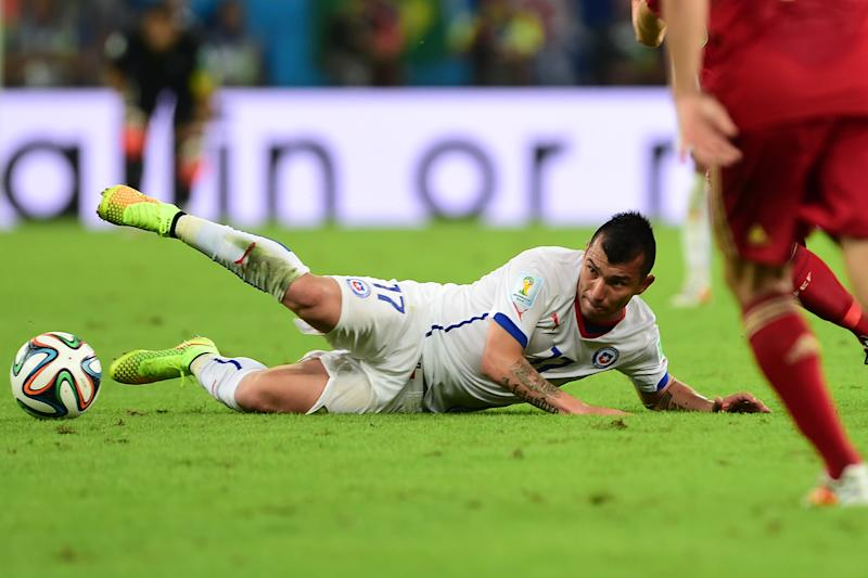 Chile's defender Gary Medel falls to the ground during a Group B football match in the Maracana Stadium in Rio de Janeiro during the 2014 FIFA World Cup on June 18, 2014