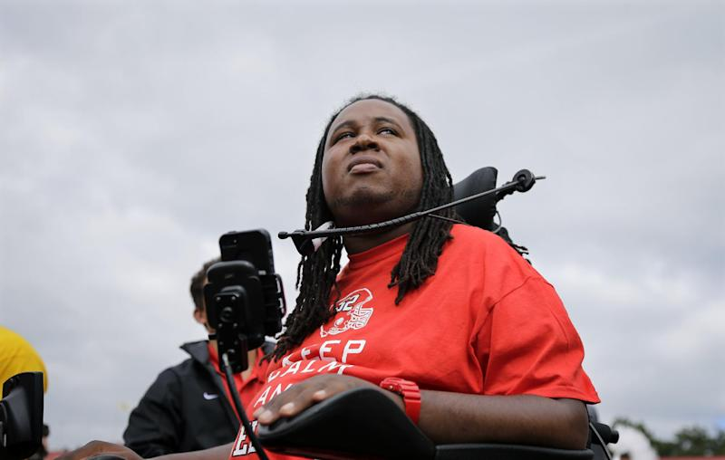 Former Rutgers football player Eric LeGrand looks up at the stands during ceremony where his jersey number 52 was retired at halftime of an NCAA college football game against Eastern Michigan in Piscataway,N.J., Saturday, Sept. 14, 2013. LeGrand became paralyzed while making a tackle in an October 2010 game