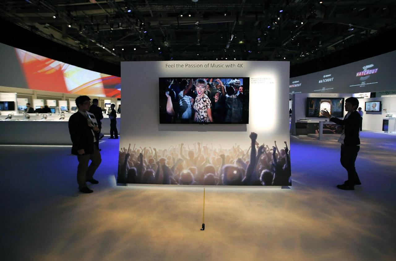 Technicians install Sony's 4k Ultra HD television at the Sony booth at the International Consumer Electronics Show in Las Vegas, Monday, Jan. 7, 2013. The 2013 International CES gadget show, the biggest trade show in the Americas, is taking place in Las Vegas this week. (AP Photo/Jae C. Hong)