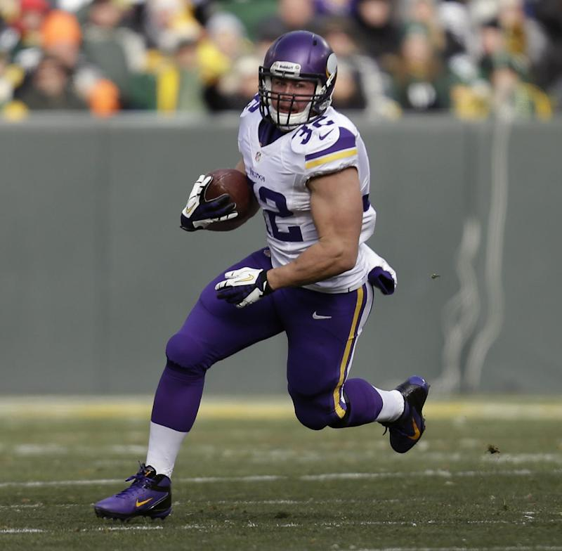 In this Nov. 24, 2013 file photo, Minnesota Vikings Toby Gerhart runs with the football during an NFL game against the Green Bay Packers at Lambeau Field in Green Bay Wis. The Jaguars contined its offensive makeover Tuesday night, March 11, 2014,  by agreeing to terms with Gerhart, a possible indication Jacksonville doesn't expect free agent Maurice Jones-Drew to return