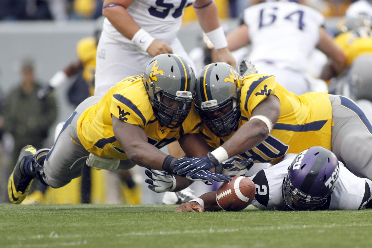 MORGANTOWN, WV - NOVEMBER 03:  Will Clarke #98 and Shaq Rowell #90 of the West Virginia Mountaineers dive for a loose ball against Trevone Boykin #2 of the TCU Horned Frogs during the game on November 3, 2012 at Mountaineer Field in Morgantown, West Virginia.  (Photo by Justin K. Aller/Getty Images)
