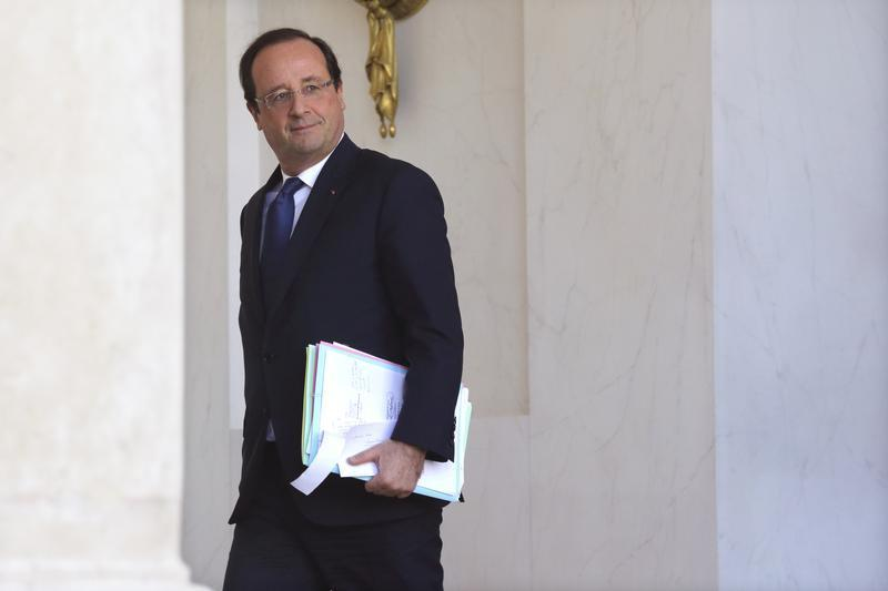 French President Hollande leaves after the weekly cabinet meeting at the Elysee Palace in Paris