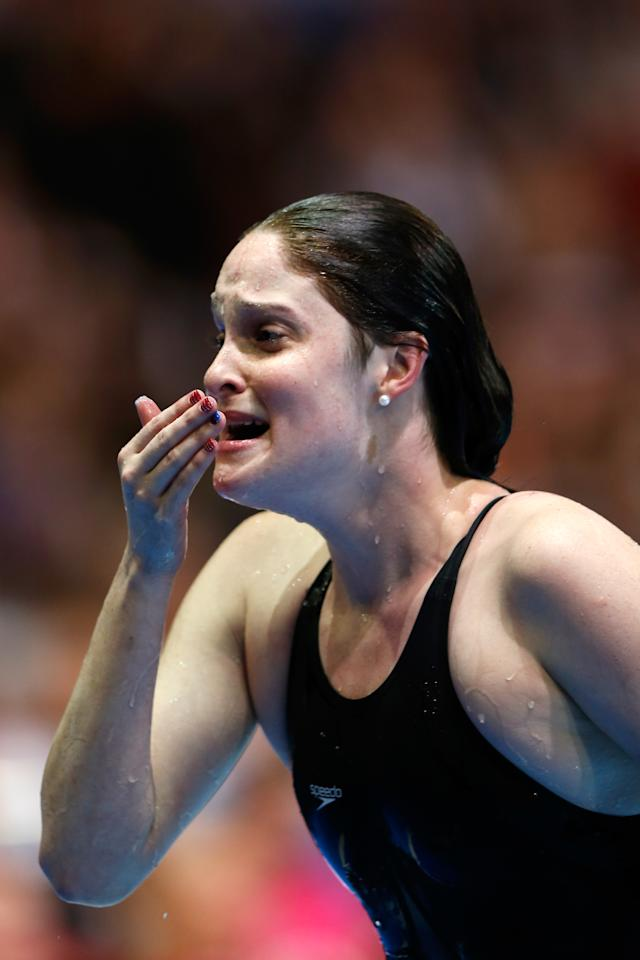 OMAHA, NE - JUNE 29:  Cammile Adams reacts after she competed in the championship final of the Women's 200 m Butterfly during Day Five of the 2012 U.S. Olympic Swimming Team Trials at CenturyLink Center on June 29, 2012 in Omaha, Nebraska.  (Photo by Jamie Squire/Getty Images)