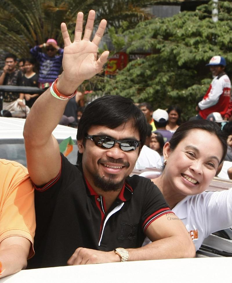 Trainer: Pacquiao may think retirement after bout