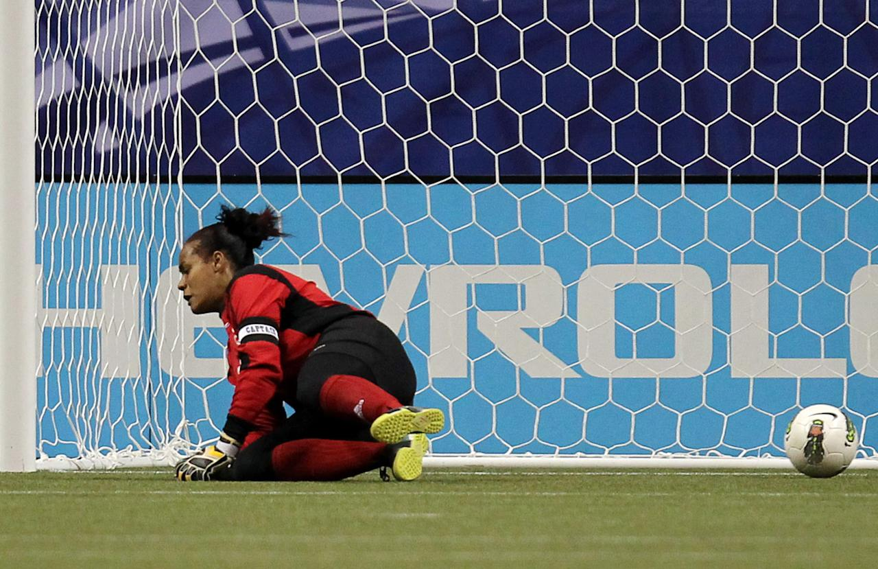 Dominican Republic goalkeeper Heidy Salazar can't block a shot for a goal by United States' Abby Wambach during the first half of a CONCACAF women's Olympic qualifying soccer match in Vancouver, British Columbia, Friday, Jan. 20, 2012. (AP Photo/The Canadian Press, Jonathan Hayward)