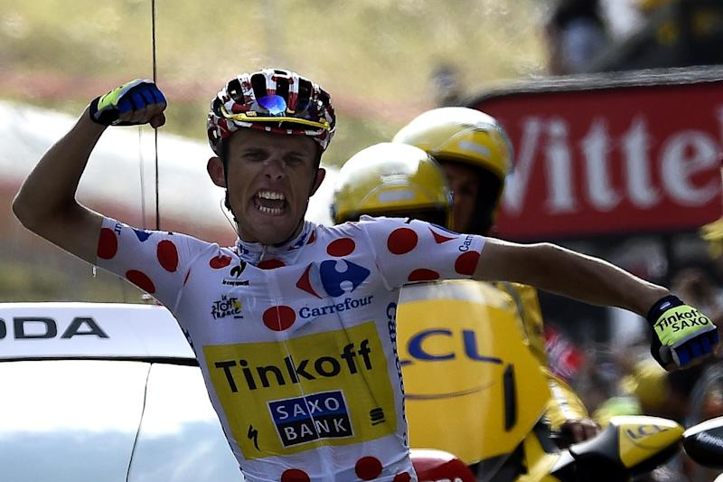 Poland's Rafal Majka wearing the best climber's polka dot jersey crosses the finish line at the end of the Tour de France 17th stage between Saint-Gaudens and Saint-Lary Pla d'Adet, southwest France on July 23, 2014