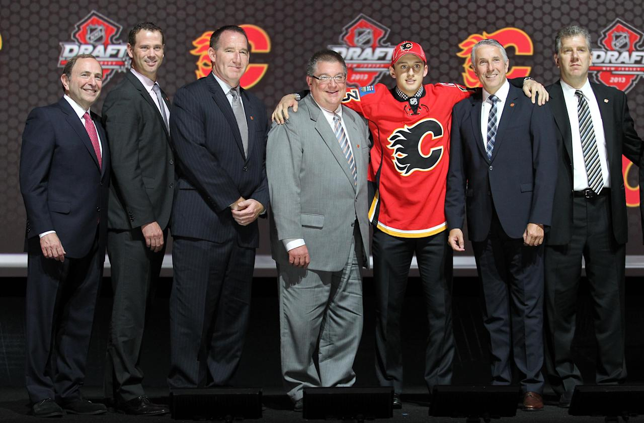 Jun 30, 2013; Newark, NJ, USA; Morgan Klimchuk poses for a photo after being introduced as the number twenty-eight overall pick to the Calgary Flames during the 2013 NHL Draft at the Prudential Center. (Ed Mulholland-USA TODAY Sports)
