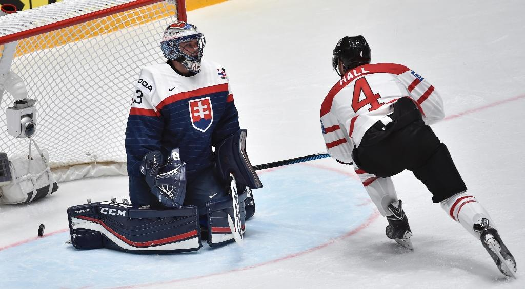 Canada's forward Taylor Hall (R) skates by Slovakia's goalie Julius Hudacek after a goal during the group B preliminary round game at the 2016 IIHF Ice Hockey World Championship in Saint Petersburg on May 14, 2016 (AFP Photo/Alexander Nemenov)