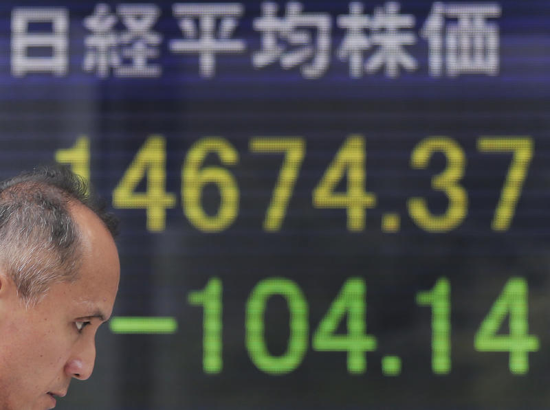 Asian shares little changed ahead of earnings