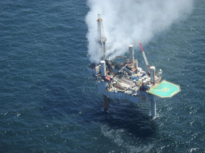 Authorities see no sheen near burning Gulf rig