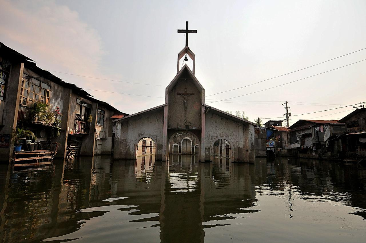 MANILA, PHILIPPINES - APRIL 28:  The remnants of the old church in in Artex Compound in Malabon City on April 28, 2013 in Manila, Philippines. The residents of the former textile compound had to adjust their daily lives after  flood waters submerged their low-lying village in 2004.  (Photo by Veejay Villafranca/Getty Images)