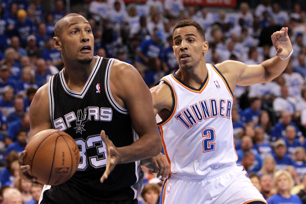 OKLAHOMA CITY, OK - JUNE 02:  Boris Diaw #33 of the San Antonio Spurs drives on Thabo Sefolosha #2 of the Oklahoma City Thunder in the first quarter in Game Four of the Western Conference Finals of the 2012 NBA Playoffs at Chesapeake Energy Arena on June 2, 2012 in Oklahoma City, Oklahoma. NOTE TO USER: User expressly acknowledges and agrees that, by downloading and or using this photograph, User is consenting to the terms and conditions of the Getty Images License Agreement.  (Photo by Ronald Martinez/Getty Images)