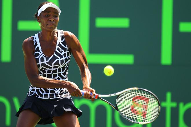 KEY BISCAYNE, FL - MARCH 28:  Venus Williams of the USA in action against Agnieszka Radwanska of Poland during Day 10 at Crandon Park Tennis Center at the Sony Ericsson Open on March 28, 2012 in Key Biscayne, Florida.  (Photo by Al Bello/Getty Images)