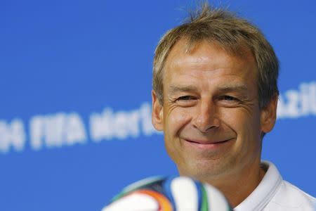 United States national soccer team head coach Jurgen Klinsmann smiles while answering a question during a news conference at the Pernambuco arena in Recife