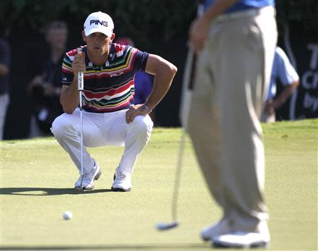Billy Horschel lines up his putt on the 18th green during the Tour Championship golf tournament in Atlanta
