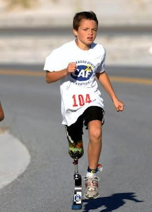 Ben Baltz competes in a previous triathlon — CaringBridge.org
