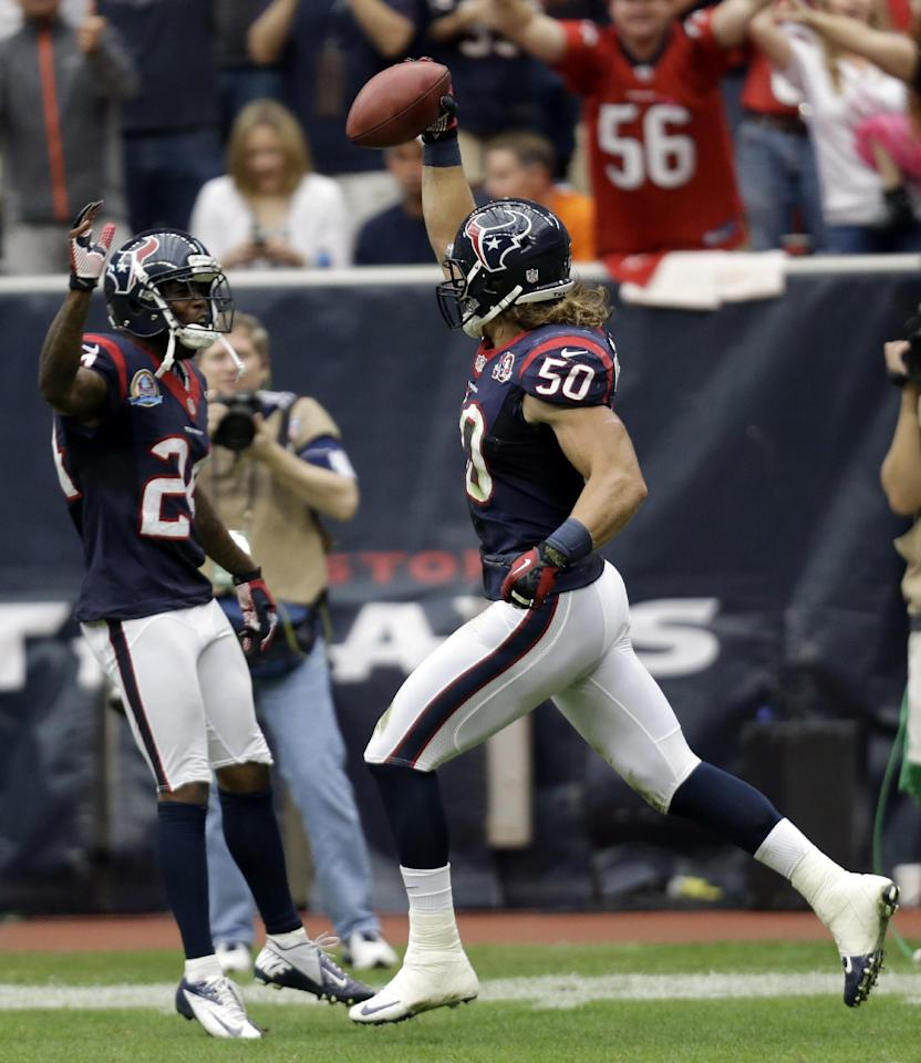 Houston Texans linebacker Bryan Braman (50) celebrates with Johnathan Joseph, left, after blocking a punt and returning it for a touchdown in the second quarter of an NFL football game against the Indianapolis Colts, Sunday, Dec. 16, 2012, in Houston. (AP Photo/Eric Gay)