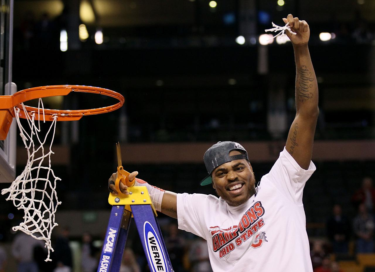 BOSTON, MA - MARCH 24:  Deshaun Thomas #1 of the Ohio State Buckeyes cuts down the net after defeating the Syracuse Orange to win the 2012 NCAA Men's Basketball East Regional Final at TD Garden on March 24, 2012 in Boston, Massachusetts.  (Photo by Elsa/Getty Images)