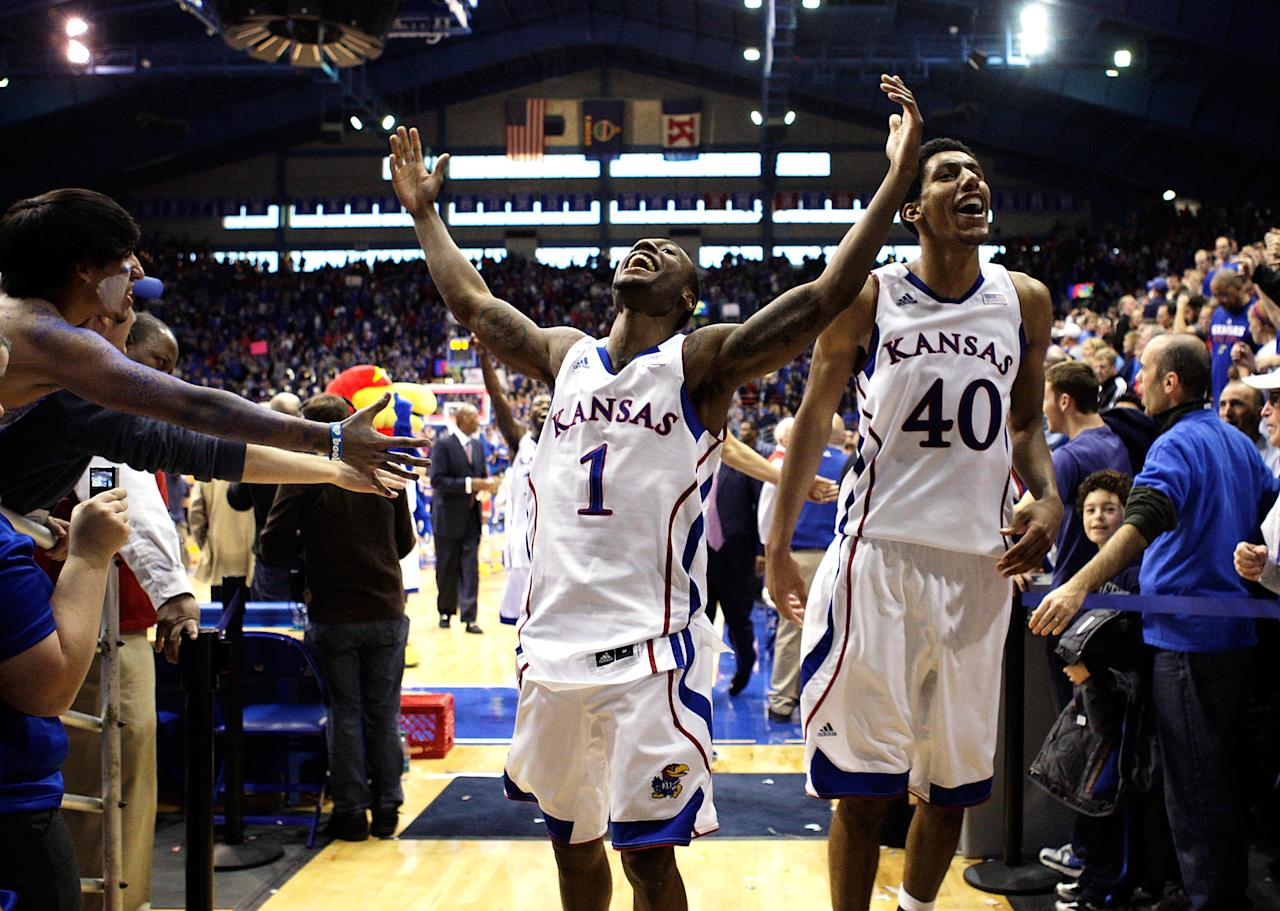 LAWRENCE, KS - DECEMBER 10:  Naadir Tharpe #1 and Kevin Young #40 of the Kansas Jayhawks celebrate as they leave the court after the Jayhawks defeated the Ohio State Buckeyes 78-67 to win the game on December 10, 2011 at Allen Fieldhouse in Lawrence, Kansas.  (Photo by Jamie Squire/Getty Images)