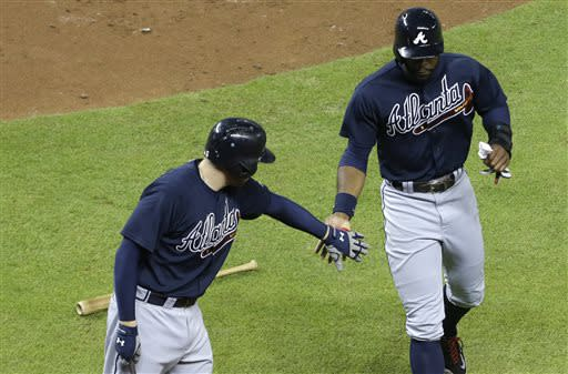 Justin Upton leads Braves past Marlins 6-4