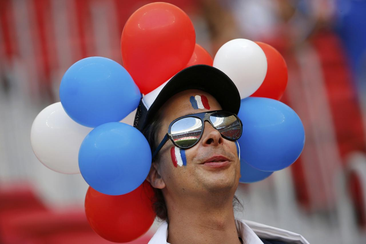 A fan of France waits for the start of the 2014 World Cup round of 16 game between France and Nigeria at the Brasilia national stadium in Brasilia June 30, 2014. REUTERS/Siphiwe Sibeko (BRAZIL - Tags: SOCCER SPORT WORLD CUP)