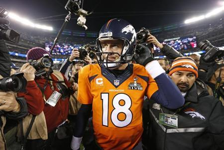 Denver Broncos quarterback Peyton Manning leaves field after being defeated by the Seattle Seahawks in the NFL Super Bowl XLVIII in East Rutherford