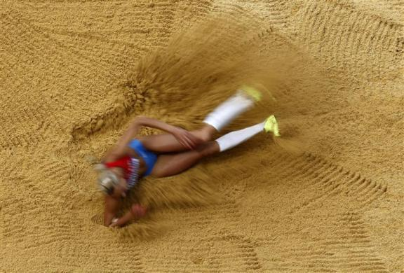 Russia's Tatyana Chernova competes during her women's heptathlon Group B long jump event at the London 2012 Olympic Games at the Olympic Stadium August 4, 2012.