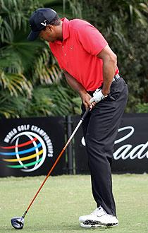 Tiger Woods winces after hitting his tee shot on No. 12 at Doral on Sunday