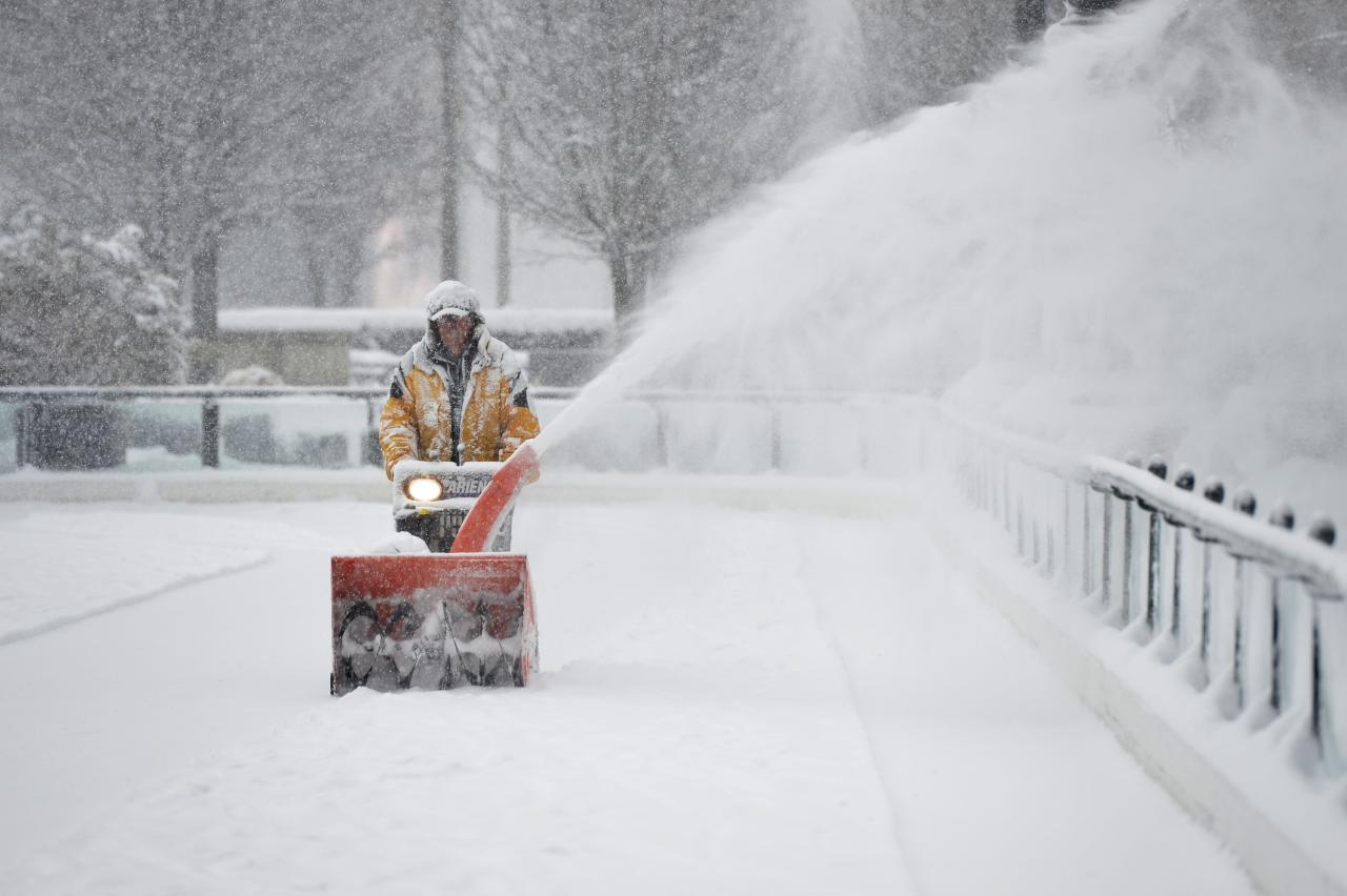 CHICAGO, IL - MARCH 5:  Mike Davis clears snow from the Millennium Park skating rink on March 5, 2013 in Chicago, Illinois. The worst winter storm of the season is expected to dump 7-10 inches of snow on the Chicago area with the worst expected for the evening commute.  (Photo by Brian Kersey/Getty Images)