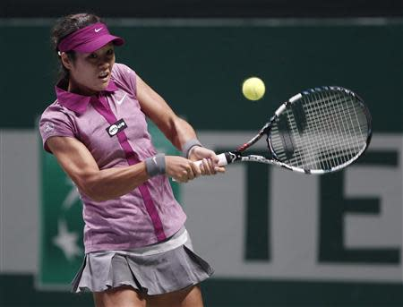 Li Na of China hits a return to Victoria Azarenka of Belarus during their WTA tennis championships match at Sinan Erdem Dome in Istanbul