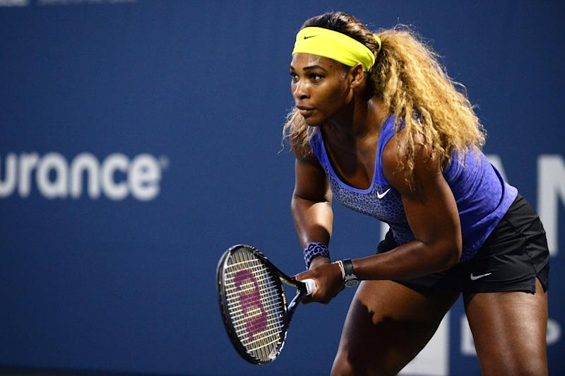 Serena Williams waits on a serve from Ana Ivanovic of Serbia during Day 5 of the Bank of the West Classic at the Taube Family Tennis Stadium on August 1, 2014 in Stanford, California