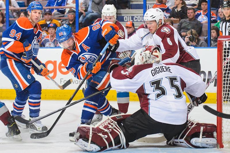 Sam Gagner of the Edmonton Oilers takes a shot on Jean-Sebastien Giguere of the Colorado Avalanche during an NHL game at Rexall Place on April 8, 2014 in Edmonton