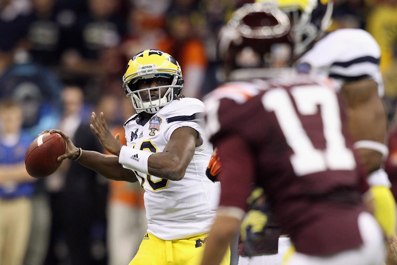 NEW ORLEANS, LA - JANUARY 03:  Denard Robinson #16 of the Michigan Wolverines throws a pass against the Virginia Tech Hokies during the Allstate Sugar Bowl at Mercedes-Benz Superdome on January 3, 2012 in New Orleans, Louisiana.  (Photo by Matthew Stockman/Getty Images)