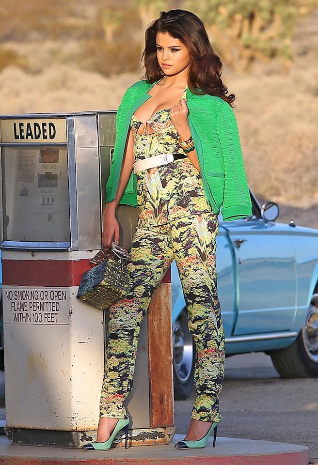 Is it just us, or is Selena Gomez looking better than ever since splitting with Justin Bieber? Earlier this week, the former Disney darling showed off her sexier side while shooting a music video in sunny Southern California. Unlike most other celebs, Selena is capable of pulling off bold prints -- and did -- in this Kenzo creation, which consisted of a bustier top and matching trousers. A bright green cardigan, metallic Kenzo bag, and cap-toe pumps completed her intriguing ensemble. (3/4/2013)