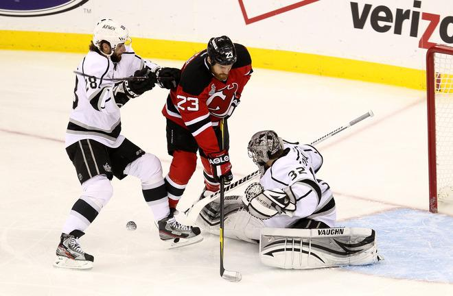 NEWARK, NJ - JUNE 02: Jarret Stoll #28 of the Los Angeles Kings and David Clarkson #23 of the New Jersey Devils fight for a loose puck in front of Jonathan Quick #32 of the Los Angeles Kings during Game Two of the 2012 NHL Stanley Cup Final at the Prudential Center on June 2, 2012 in Newark, New Jersey.  (Photo by Jim McIsaac/Getty Images)